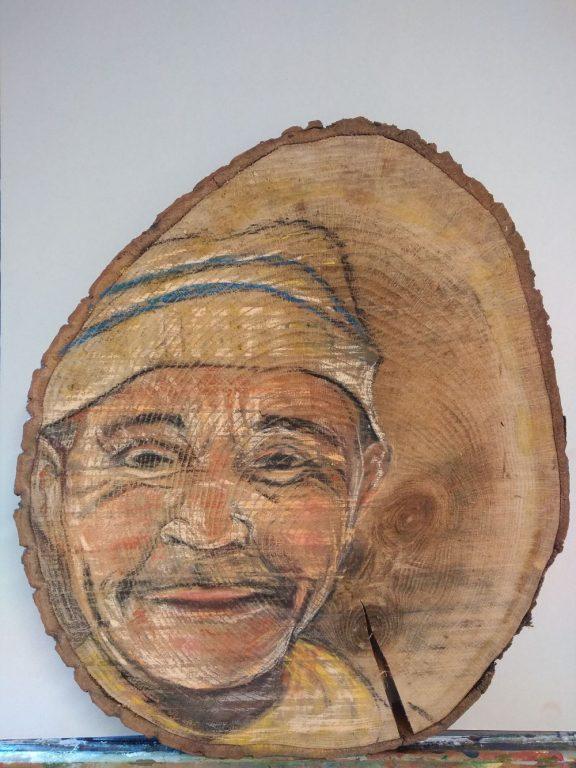 Man op schijf hout 40 x 50 cm